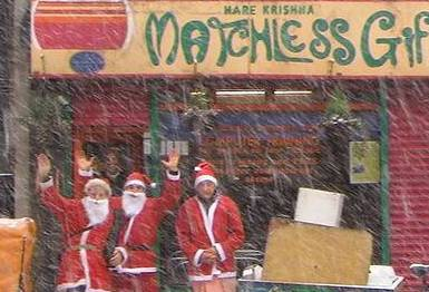 Students brave the snows to get their presents from the Santa clauses of Matchless Gifts! thumbnail